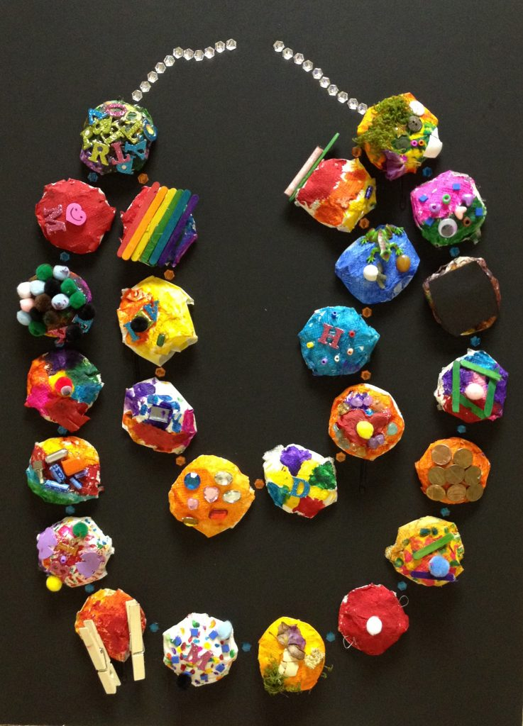 """Mardi Gras Bead Necklace"" Ms. del Rosario's Class 1st Grade"